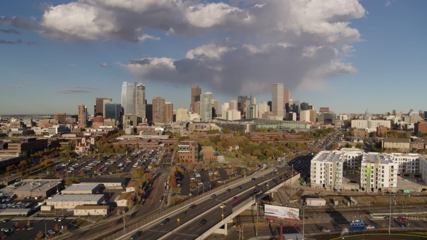 5.7K stock footage aerial video of the city skyline seen while ascending by W Colfax Avenue, Downtown Denver, Colorado Aerial Stock Footage | DX0001_001544