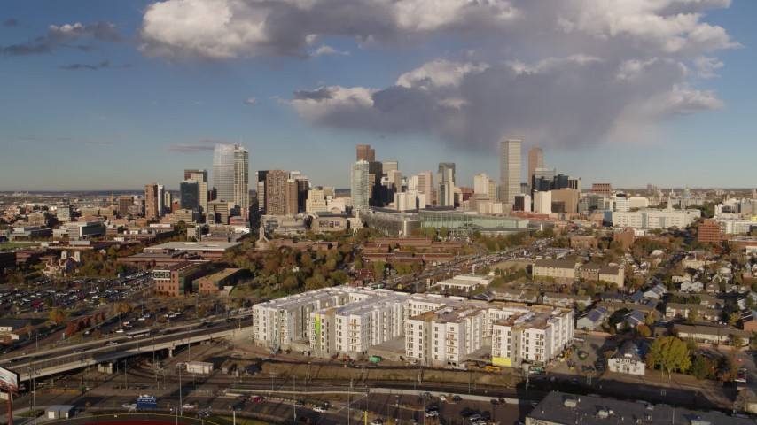 5.7K stock footage aerial video of the city skyline seen while flying away from W Colfax Avenue, Downtown Denver, Colorado Aerial Stock Footage | DX0001_001545