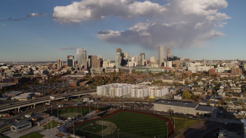 5.7K aerial video of flying by the city skyline, Downtown Denver, Colorado Aerial Stock Footage | DX0001_001547