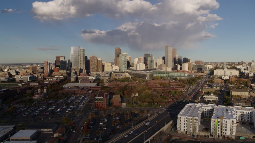 5.7K stock footage aerial video of a reverse view of W Colfax Avenue and the city skyline, Downtown Denver, Colorado Aerial Stock Footage | DX0001_001549