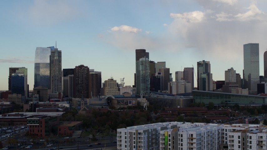 5.7K stock footage aerial video of flying by the city skyline with clouds in the sky, Downtown Denver, Colorado Aerial Stock Footage | DX0001_001551