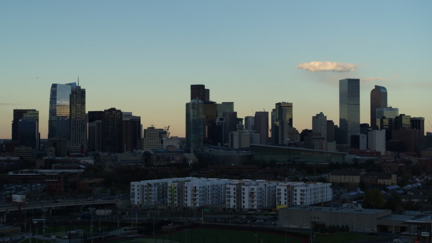 5.7K stock footage aerial video slowly flyby tall skyscrapers in the city skyline at sunset, Downtown Denver, Colorado Aerial Stock Footage | DX0001_001554