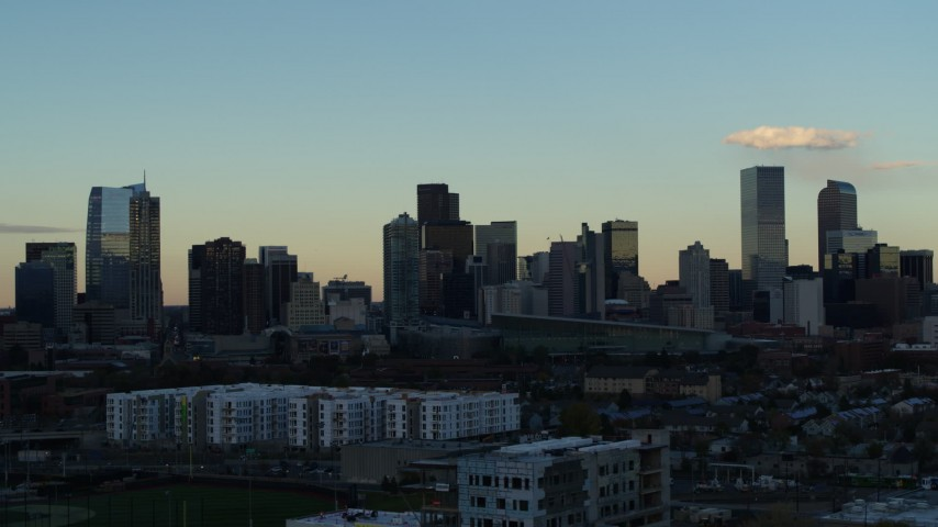 5.7K stock footage aerial video of passing tall skyscrapers in the city skyline at sunset, Downtown Denver, Colorado Aerial Stock Footage | DX0001_001555