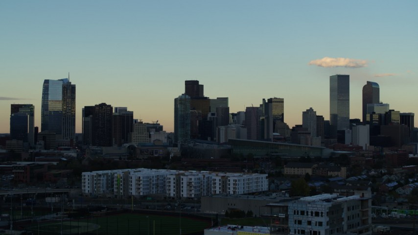 5.7K stock footage aerial video of the tall skyscrapers in the city skyline at sunset, Downtown Denver, Colorado Aerial Stock Footage | DX0001_001556