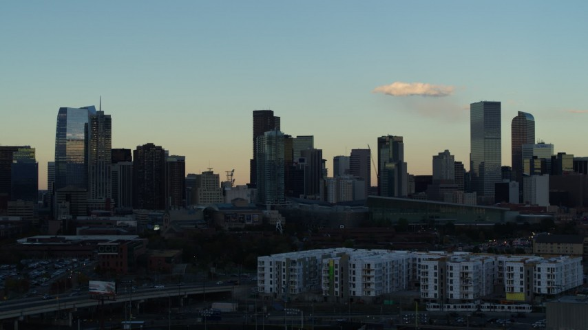 5.7K stock footage aerial video of the towering skyscrapers in the city skyline at sunset, Downtown Denver, Colorado Aerial Stock Footage | DX0001_001557