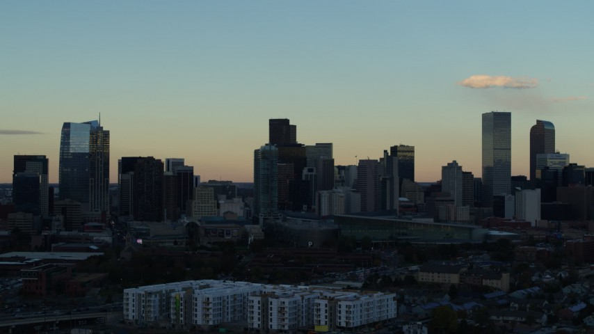 5.7K stock footage aerial video stationary view of towering skyscrapers in the city skyline at sunset, Downtown Denver, Colorado Aerial Stock Footage | DX0001_001560