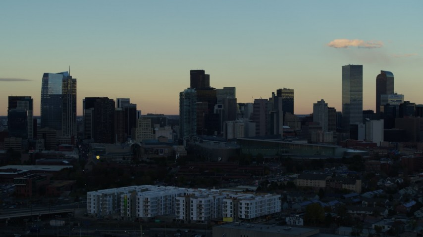 5.7K stock footage aerial video stationary view of skyscrapers in the city skyline at sunset, Downtown Denver, Colorado Aerial Stock Footage | DX0001_001561