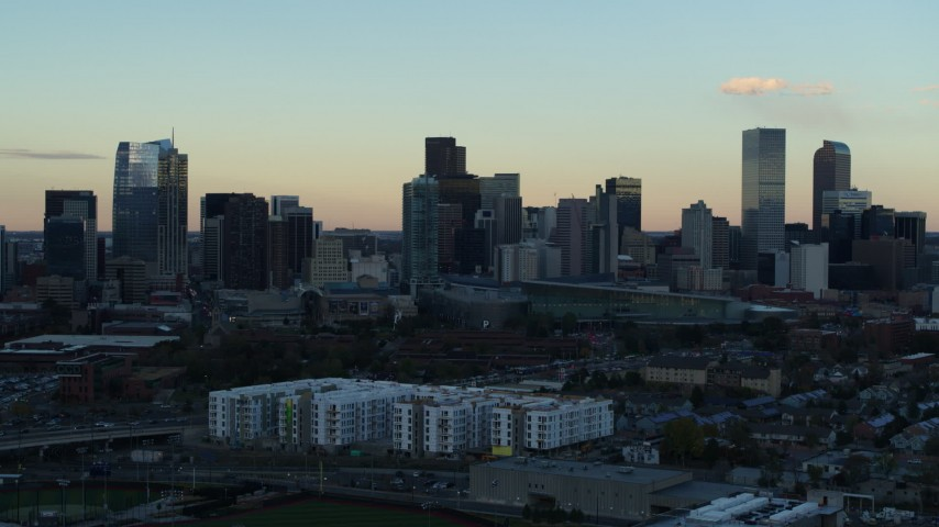 5.7K stock footage aerial video stationary view of the city's skyline at sunset before descent, Downtown Denver, Colorado Aerial Stock Footage | DX0001_001563