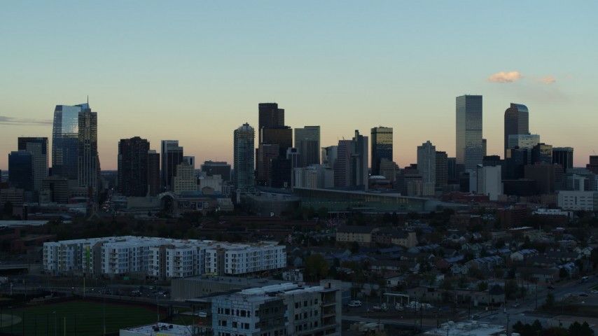 5.7K stock footage aerial video of slowly flying by the city's skyline at sunset, Downtown Denver, Colorado Aerial Stock Footage | DX0001_001564