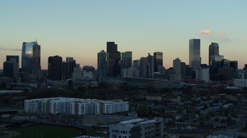 5.7K stock footage aerial video of slowly passing by the city's skyline at sunset, Downtown Denver, Colorado Aerial Stock Footage | DX0001_001565