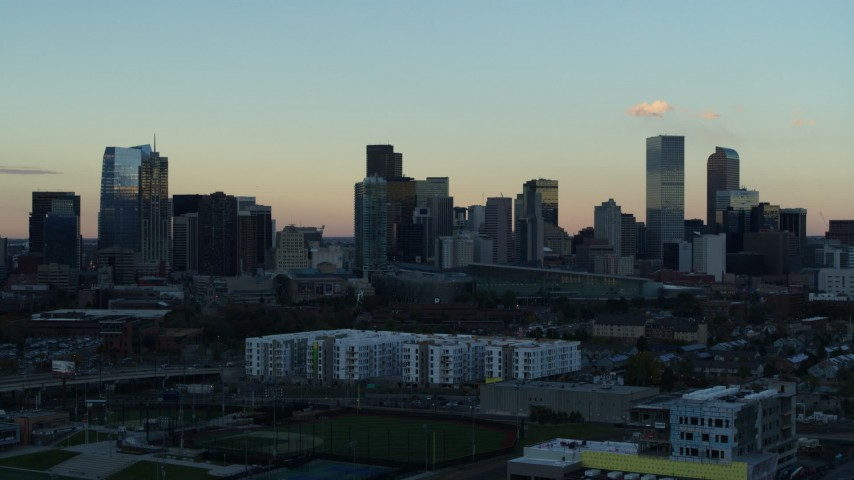 5.7K stock footage aerial video of a reverse view of the city's skyline at sunset, Downtown Denver, Colorado Aerial Stock Footage | DX0001_001567