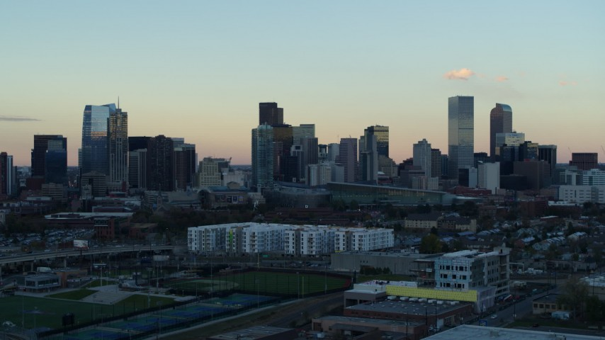 5.7K stock footage aerial video of a reverse view of the city's skyline at sunset before descent, Downtown Denver, Colorado Aerial Stock Footage | DX0001_001568