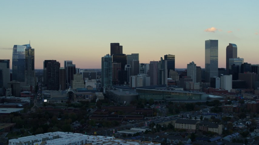 5.7K stock footage aerial video of a pass of the city's skyline at sunset, Downtown Denver, Colorado Aerial Stock Footage | DX0001_001570