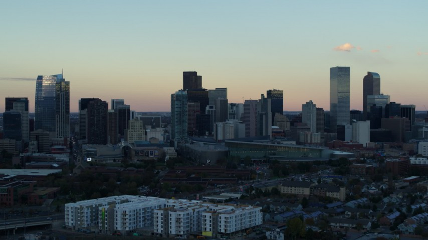 5.7K stock footage aerial video fly away from the city's skyline at sunset before descent, Downtown Denver, Colorado Aerial Stock Footage | DX0001_001571