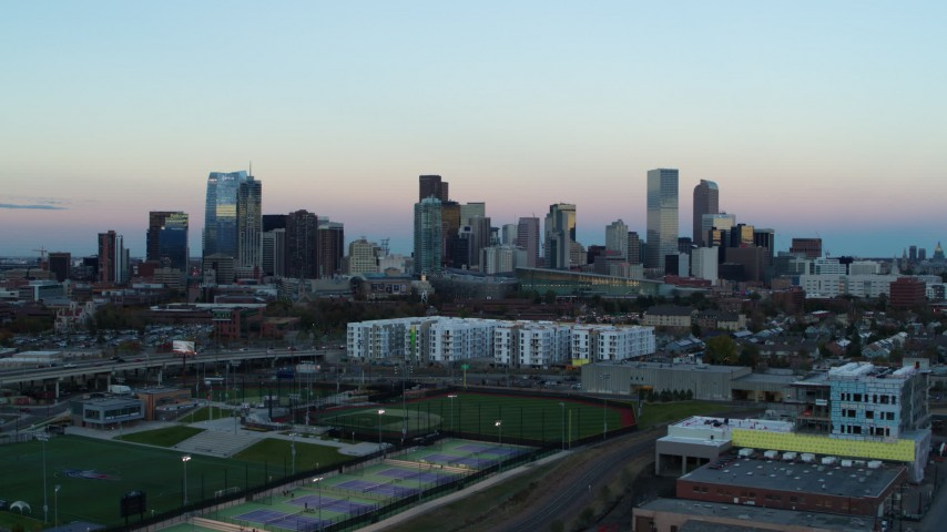 5.7K stock footage aerial video of flying by the city's downtown skyline at sunset, Downtown Denver, Colorado Aerial Stock Footage | DX0001_001572