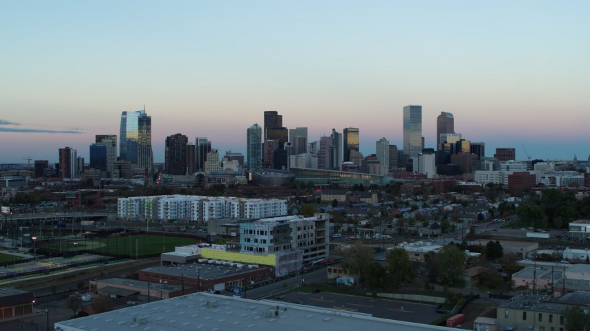 5.7K stock footage aerial video of passing by the city's downtown skyline at sunset, Downtown Denver, Colorado Aerial Stock Footage | DX0001_001573