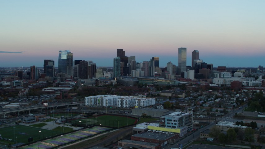 5.7K stock footage aerial video of a reverse view of the city's downtown skyline at sunset, Downtown Denver, Colorado Aerial Stock Footage | DX0001_001576