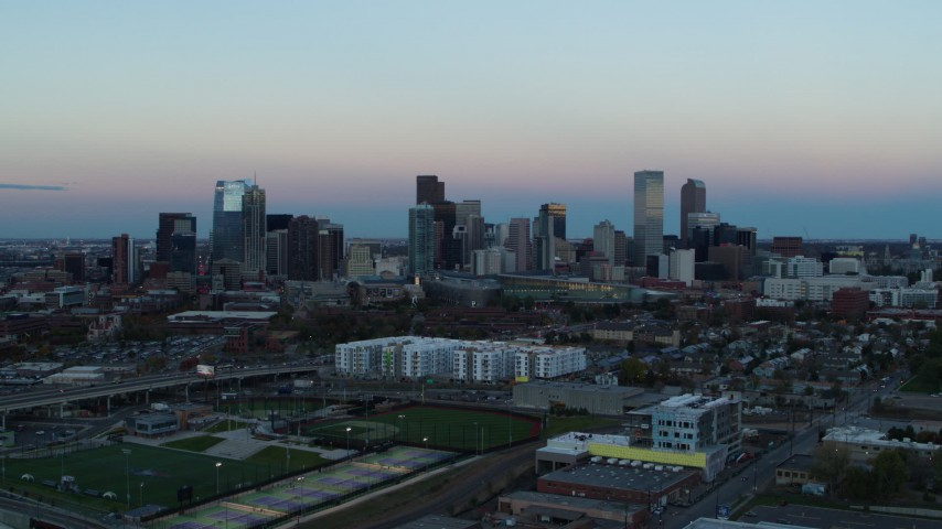 5.7K stock footage aerial video of a slow approach to the city's downtown skyline at sunset, Downtown Denver, Colorado Aerial Stock Footage DX0001_001577
