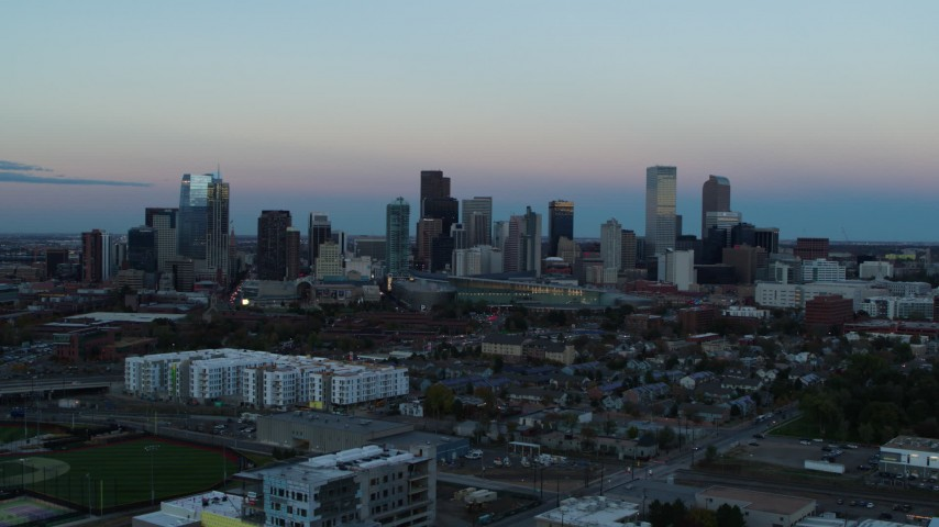 5.7K stock footage aerial video fly away from and flyby the city's downtown skyline at sunset, Downtown Denver, Colorado Aerial Stock Footage | DX0001_001579