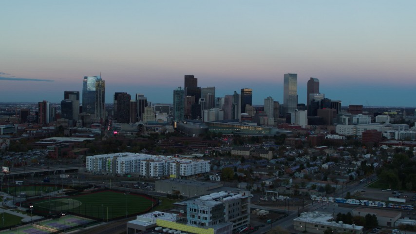 5.7K stock footage aerial video of a stationary view and flyby of the city's downtown skyline at sunset, Downtown Denver, Colorado Aerial Stock Footage | DX0001_001580