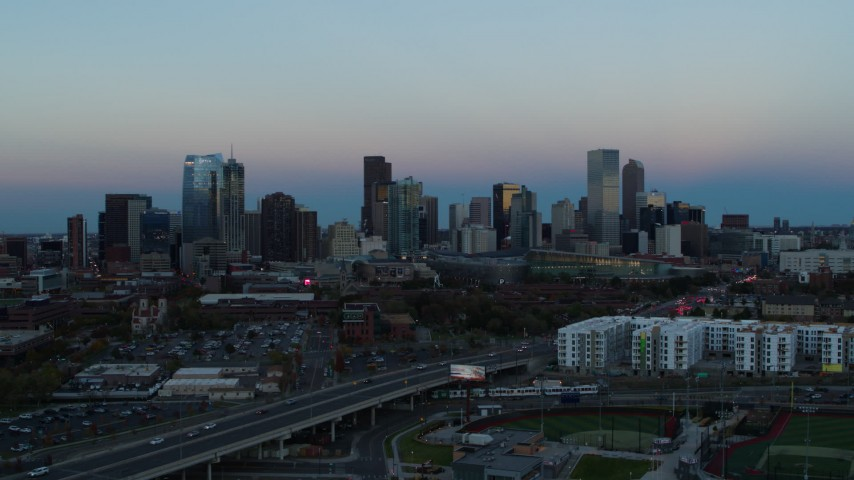 5.7K stock footage aerial video flyby the city's downtown skyline at sunset, seen while descending, Downtown Denver, Colorado Aerial Stock Footage | DX0001_001582