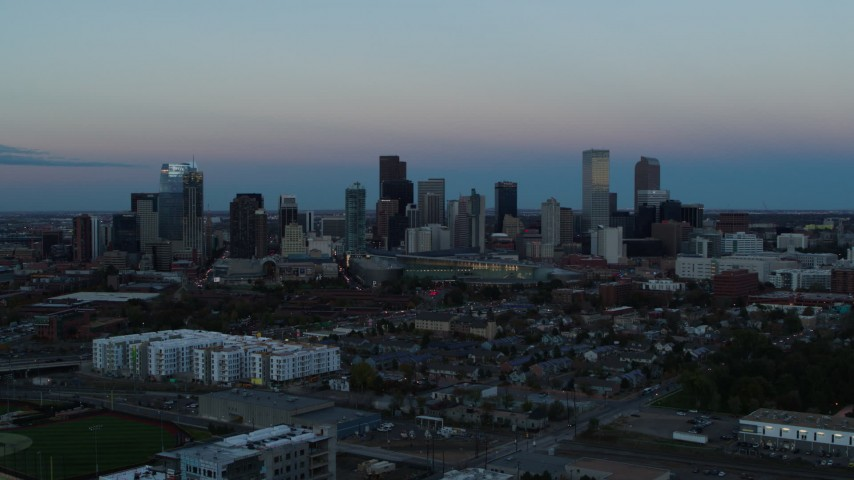 5.7K stock footage aerial video descend with view of the city's downtown skyline at sunset, Downtown Denver, Colorado Aerial Stock Footage | DX0001_001584