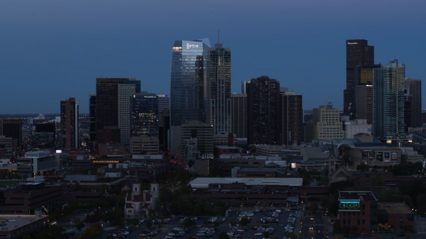 5.7K stock footage aerial video of flying by skyscrapers and hotel high-rise at twilight, Downtown Denver, Colorado Aerial Stock Footage | DX0001_001587