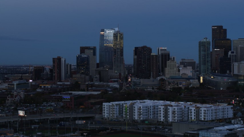 5.7K stock footage aerial video of flyby skyscrapers and hotel high-rise at twilight, Downtown Denver, Colorado Aerial Stock Footage | DX0001_001588