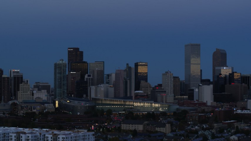 5.7K stock footage aerial video of flying by the city's downtown skyscrapers by convention center at twilight, Downtown Denver, Colorado Aerial Stock Footage | DX0001_001589