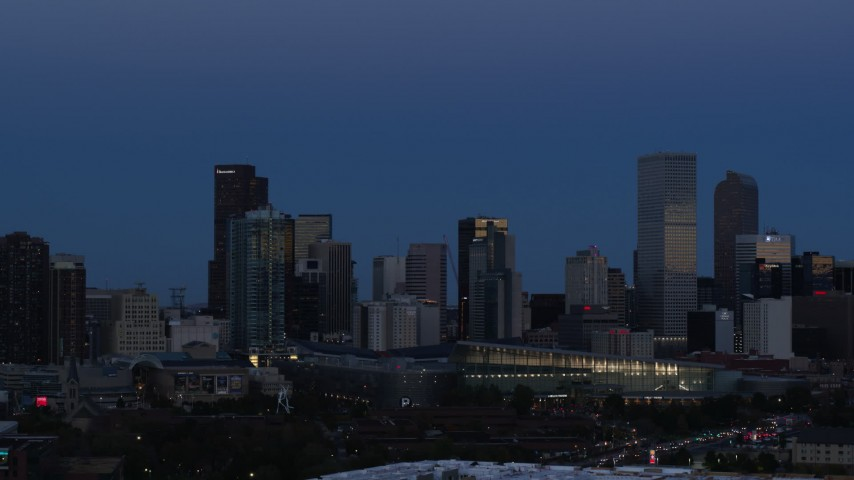 5.7K stock footage aerial video of the city's downtown skyscrapers by convention center at twilight, Downtown Denver, Colorado Aerial Stock Footage | DX0001_001591