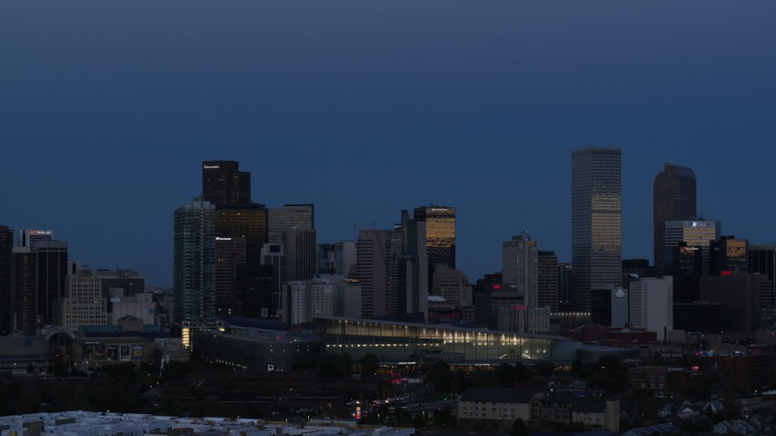 5.7K stock footage aerial video of the city's downtown skyscrapers by the convention center at twilight, Downtown Denver, Colorado Aerial Stock Footage | DX0001_001592