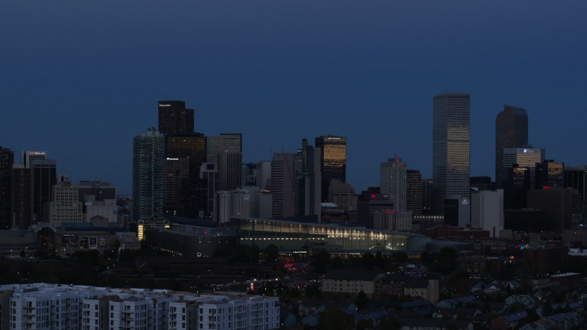 5.7K stock footage aerial video of the city's skyscrapers by convention center at twilight, then descend, Downtown Denver, Colorado Aerial Stock Footage | DX0001_001593