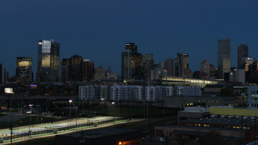 5.7K stock footage aerial video flyby and stationary view of the city's skyscrapers at twilight, Downtown Denver, Colorado Aerial Stock Footage | DX0001_001594
