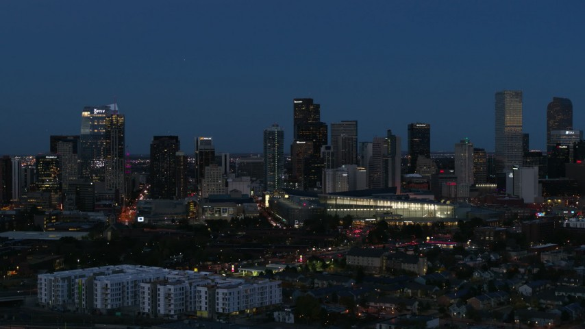 5.7K stock footage aerial video passing the city's skyscrapers and convention center at twilight, Downtown Denver, Colorado Aerial Stock Footage | DX0001_001597
