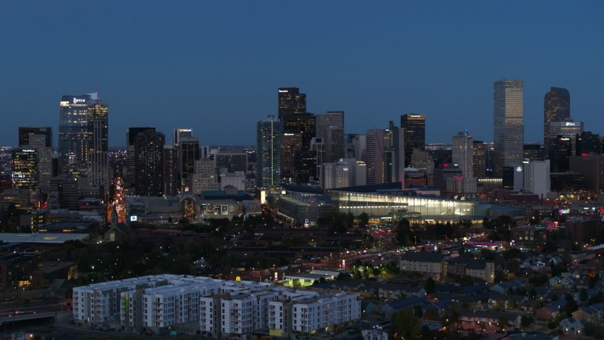 5.7K stock footage aerial video passing the city's skyscrapers and convention center at twilight, Downtown Denver, Colorado Aerial Stock Footage | DX0001_001598