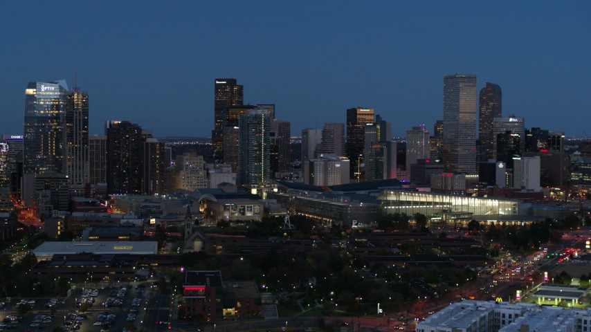 5.7K stock footage aerial video slow flyby of the city's skyscrapers and convention center at twilight, Downtown Denver, Colorado Aerial Stock Footage DX0001_001599 | Axiom Images