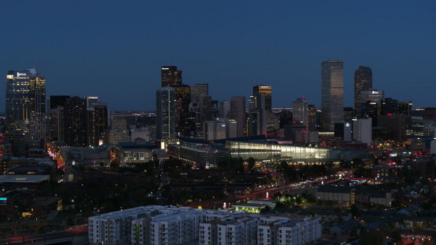 5.7K stock footage aerial video flyby the convention center and city skyline at twilight, Downtown Denver, Colorado Aerial Stock Footage | DX0001_001601