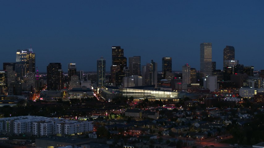 5.7K stock footage aerial video of the convention center and city skyline at twilight, Downtown Denver, Colorado Aerial Stock Footage | DX0001_001602