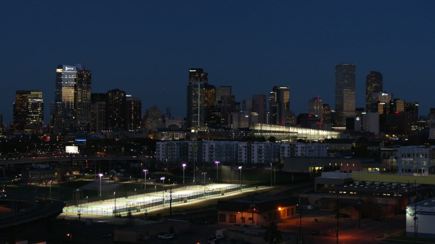 5.7K stock footage aerial video of the city skyline at twilight during seen while flying low, Downtown Denver, Colorado Aerial Stock Footage | DX0001_001605