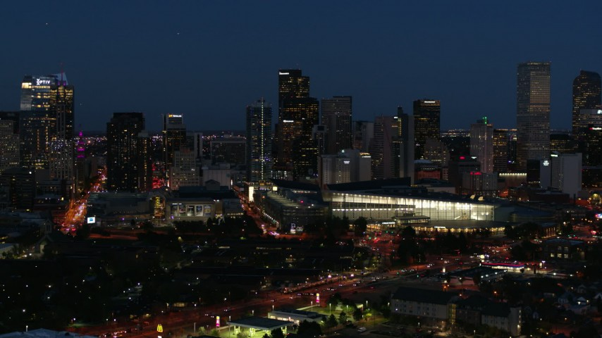 5.7K stock footage aerial video of the city skyline behind the convention center at twilight, Downtown Denver, Colorado Aerial Stock Footage | DX0001_001607