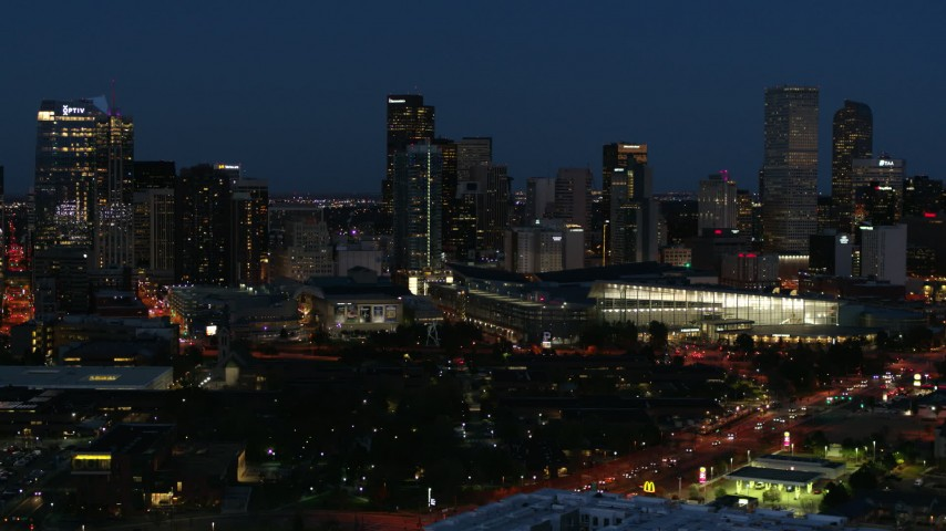 5.7K stock footage aerial video of the city skyline behind the convention center at twilight, Downtown Denver, Colorado Aerial Stock Footage DX0001_001608