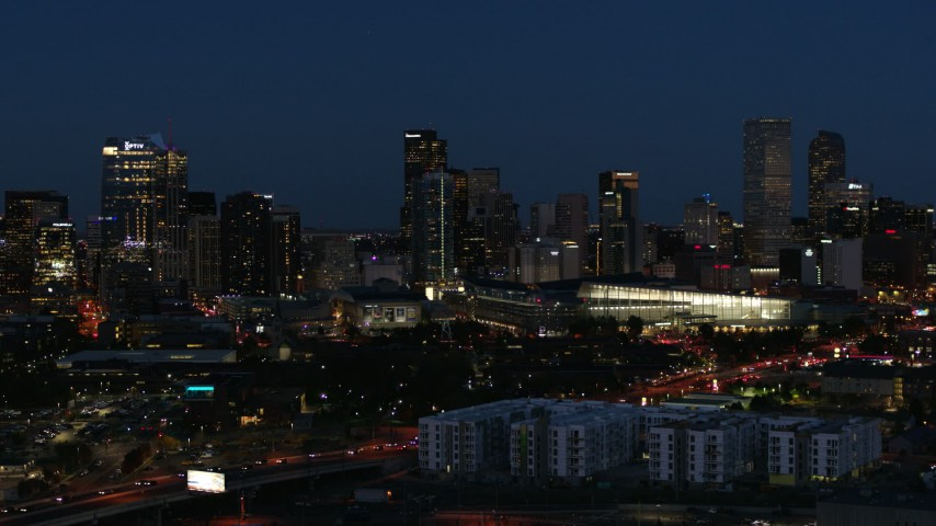5.7K stock footage aerial video reverse view of the city skyline behind the convention center at twilight, Downtown Denver, Colorado Aerial Stock Footage | DX0001_001609