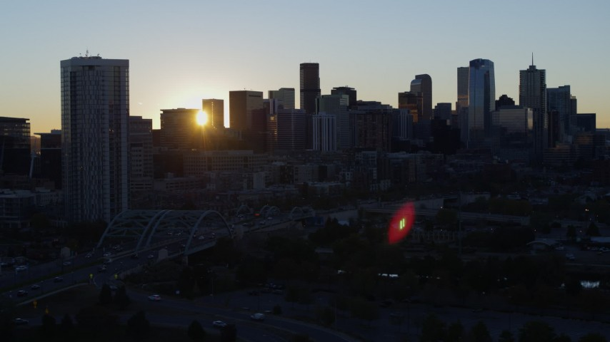 5.7K stock footage aerial video of the city skyline behind residential skyscraper at sunrise, Downtown Denver, Colorado Aerial Stock Footage | DX0001_001610