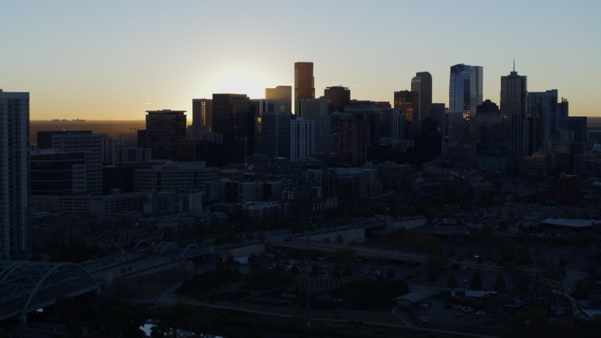 5.7K stock footage aerial video of the city skyline at sunrise, reveal residential skyscraper in Downtown Denver, Colorado Aerial Stock Footage | DX0001_001612