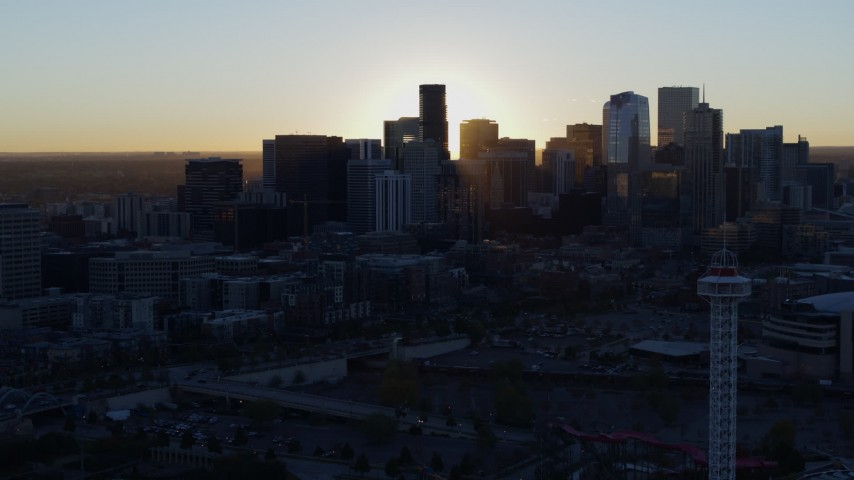 5.7K stock footage aerial video of the sun behind the city skyline at sunrise in Downtown Denver, Colorado Aerial Stock Footage | DX0001_001614