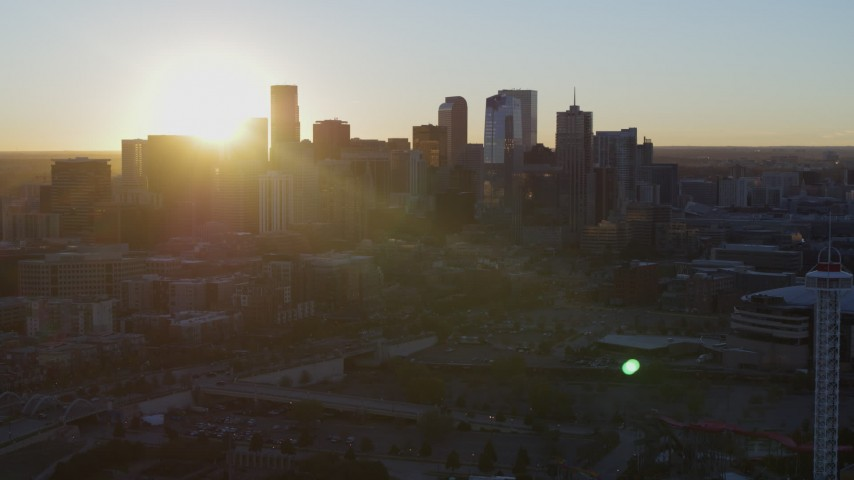 5.7K stock footage aerial video of the rising sun behind the city skyline at sunrise in Downtown Denver, Colorado Aerial Stock Footage | DX0001_001615