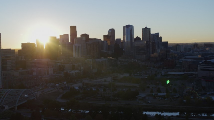 5.7K stock footage aerial video flyby skyscraper for view of city skyline at sunrise in Downtown Denver, Colorado Aerial Stock Footage | DX0001_001617