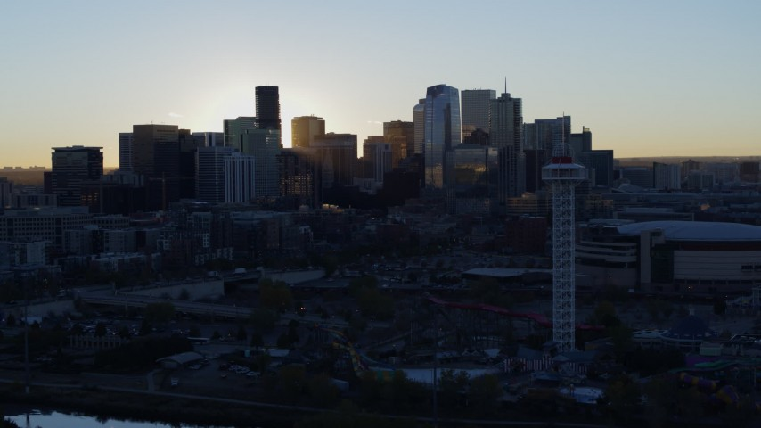 5.7K stock footage aerial video flyby rising sun and city skyline at sunrise in Downtown Denver, Colorado Aerial Stock Footage | DX0001_001618