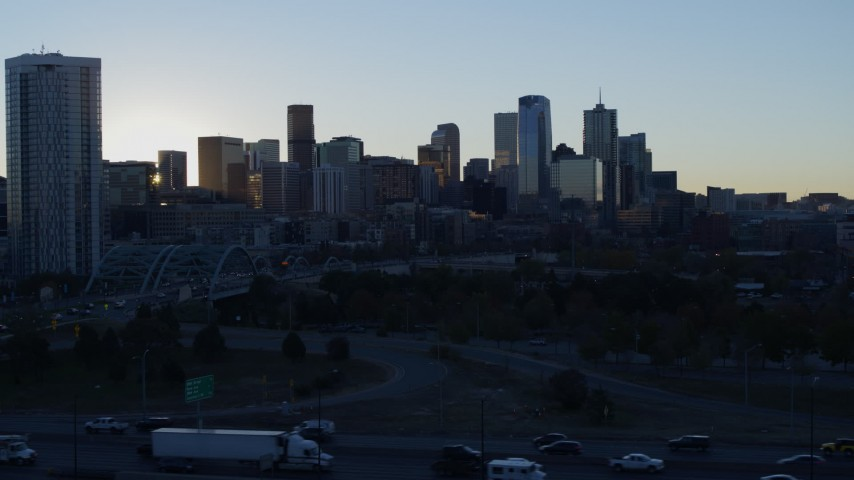 5.7K stock footage aerial video descend with view of bright sun and city skyline at sunrise in Downtown Denver, Colorado Aerial Stock Footage | DX0001_001620