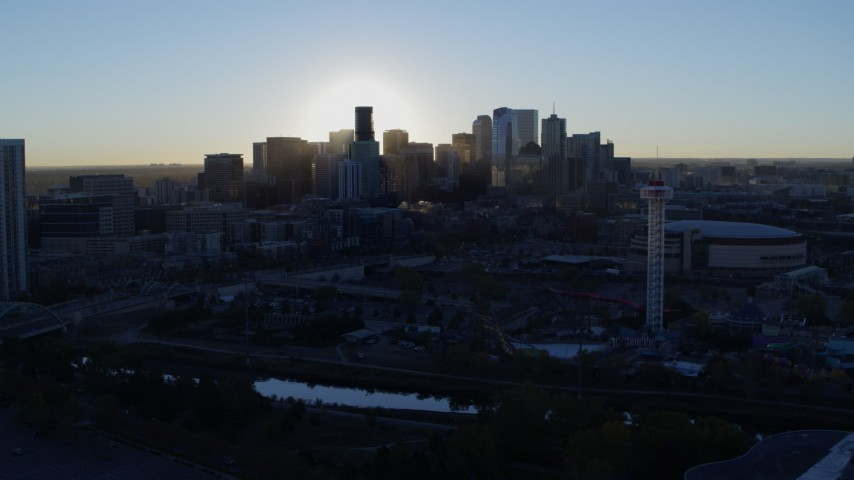 5.7K stock footage aerial video flyby bright sun and city skyline, seen from theme park and arena at sunrise in Downtown Denver, Colorado Aerial Stock Footage | DX0001_001622